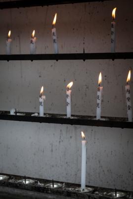 Candles burning at Kinkakuji